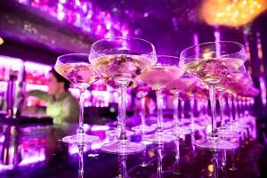 Glasses of champagne on bar